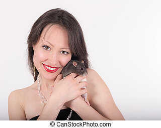 smiling girl with a rat