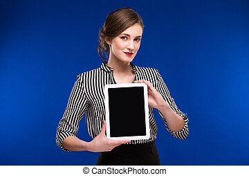 girl with a tablet in hands
