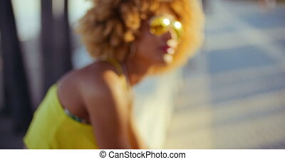 Smiling Girl with Afro Resting on Promenade - Sexy Smiling...