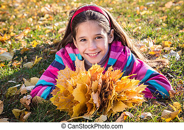 girl with autumn leaves