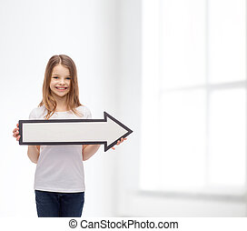 smiling girl with blank arrow pointing right