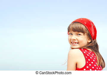 smiling girl with blue sky background