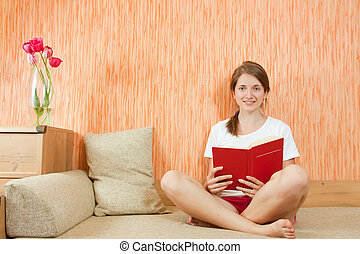 Smiling girl with book - Pretty girl in shorts reading on...