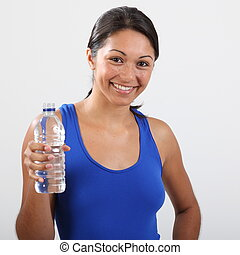 Smiling girl with bottled water