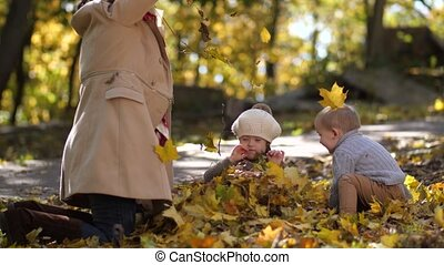 Smiling girl with down syndrome in pile of leaves