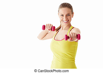 Smiling girl with dumbbells