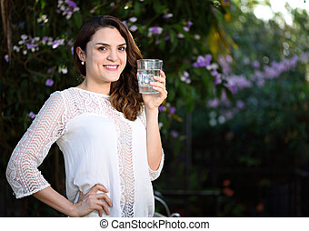 smiling girl with glass water