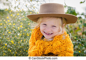 smiling girl with hat