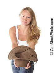 Smiling girl with hat in hand