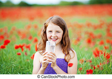 Smiling girl with mineral water