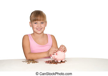 Smiling girl with piggy bank on teh table isolated
