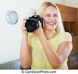 Smiling girl with professional photocamera