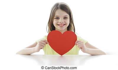 smiling girl with red heart at home - love, home, happiness,...