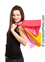 Smiling girl with shopping bags - Young smiling woman...