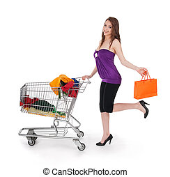 Smiling girl with shopping cart and orange bag
