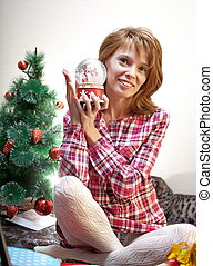 Smiling girl with snowglobe in her hand