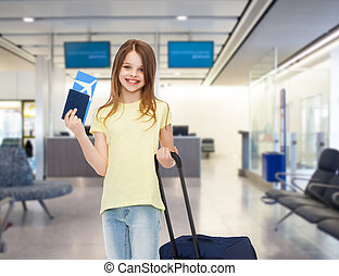 smiling girl with travel bag ticket and passport - tourism,...