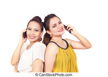 Smiling girls on phone