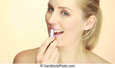 Smiling Glamorous Lady Applying Lipstick