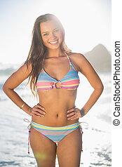 Smiling gorgeous woman in bikini posing