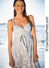 Smiling gorgeous woman in summer dress posing