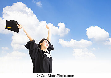 smiling  Graduate woman  with cloud background