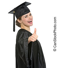Smiling graduation student woman showing thumbs up isolated
