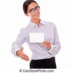 Smiling greeting businesswoman with visit card