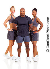 group of personal trainers - smiling group of personal...