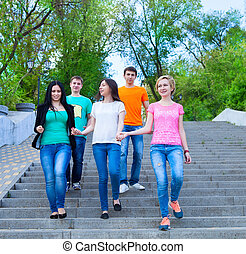 Smiling group of teenagers walking outdoors