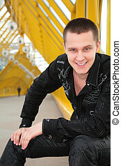 smiling guy  on yellow footbridge