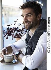 Smiling guy with coffee