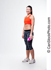 smiling gym dressed woman with her bottle