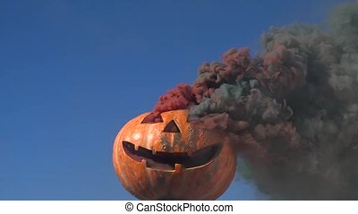 Smiling halloween pumpkin with red and green smoke. Slow motion