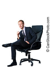 smiling handsome businessman sitting in black office chair