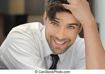Smiling handsome guy - Handsome young man leaning on his...