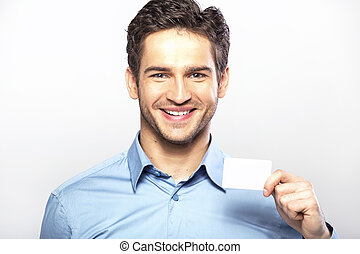 Smiling handsome guy with business card - Smiling handsome...