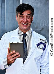Smiling Handsome Male Doctor With Tablet