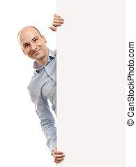smiling handsome man posing behind a billboard