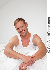 Smiling handsome muscular young man