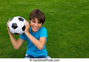 boy holding football ball