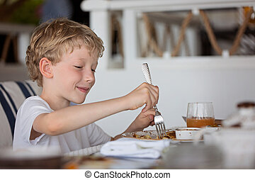 boy enjoying breakfast
