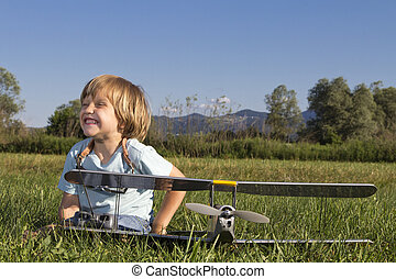Smiling happy  boy with RC plane