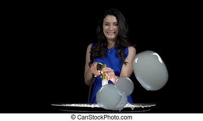 Smiling happy brunette girl blowing bubbles