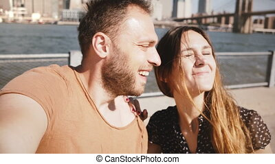 Smiling happy Caucasian young couple stand at epic New York...
