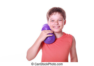 Smiling happy child playing sports with weights isolated on ...