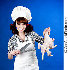 woman holds a Crude hen and knife