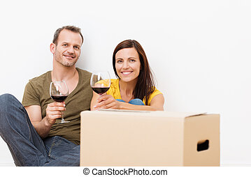 Smiling happy couple drinking wine