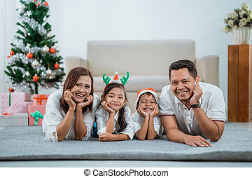 happy family together enjoying their christmas day