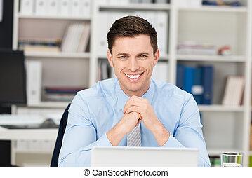 Smiling happy handsome businessman